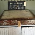 White Slant Desk & No Parking Sign